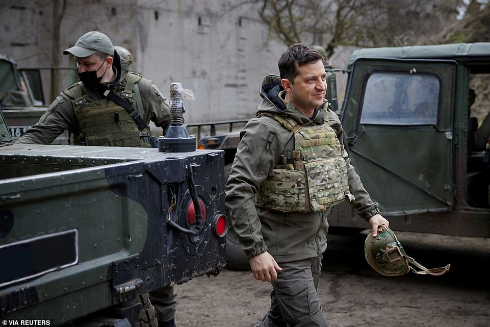 Pictured: Ukraine's President Volodymyr Zelenskiy visits positions of armed forces near the frontline with Russian-backed separatists in Donbass region, Ukraine April 9, 2021