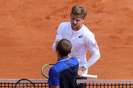 Britain's Daniel Evans (Down) shakes hands with Belgium's David Goffin after winning in their quarter final singles match on day seven of the Monte-Carlo ATP Masters Series tournament in Monaco on April 16, 2021.