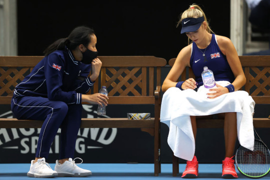 Great Britain's captain Anne Keothavong (L) and Katie Boulter of Great Britain (R) chat during match one between Katie Boulter of Great Britain and Marcela Zacarías of Mexico during day 1 of the Billie Jean King Cup Play-Offs between Great Britain and Mexico at National Tennis Centre on April 16, 2021 in London, England.