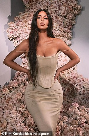 Hourglass: Kim is seen surrounded by an incredible floral display wearing a Vivienne Westwood dress