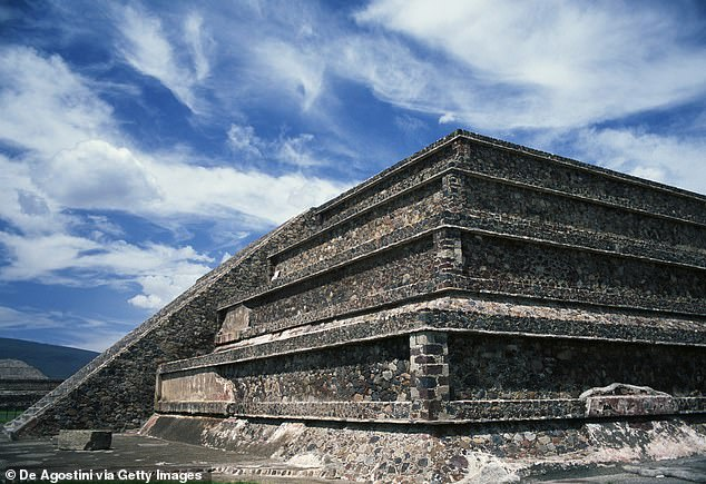 The structures at Tikal appear to be part of a compound that was a near-replica of the Citadel, a complex in the rival city-state Teotihuacan. Pictured: One of the pyramids in the Citadel
