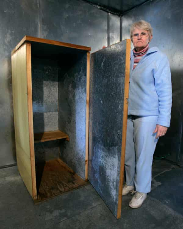 Mary Henderson, the office manager of the Wilhelm Reich Museum, displays an 'orgone' accumulator.