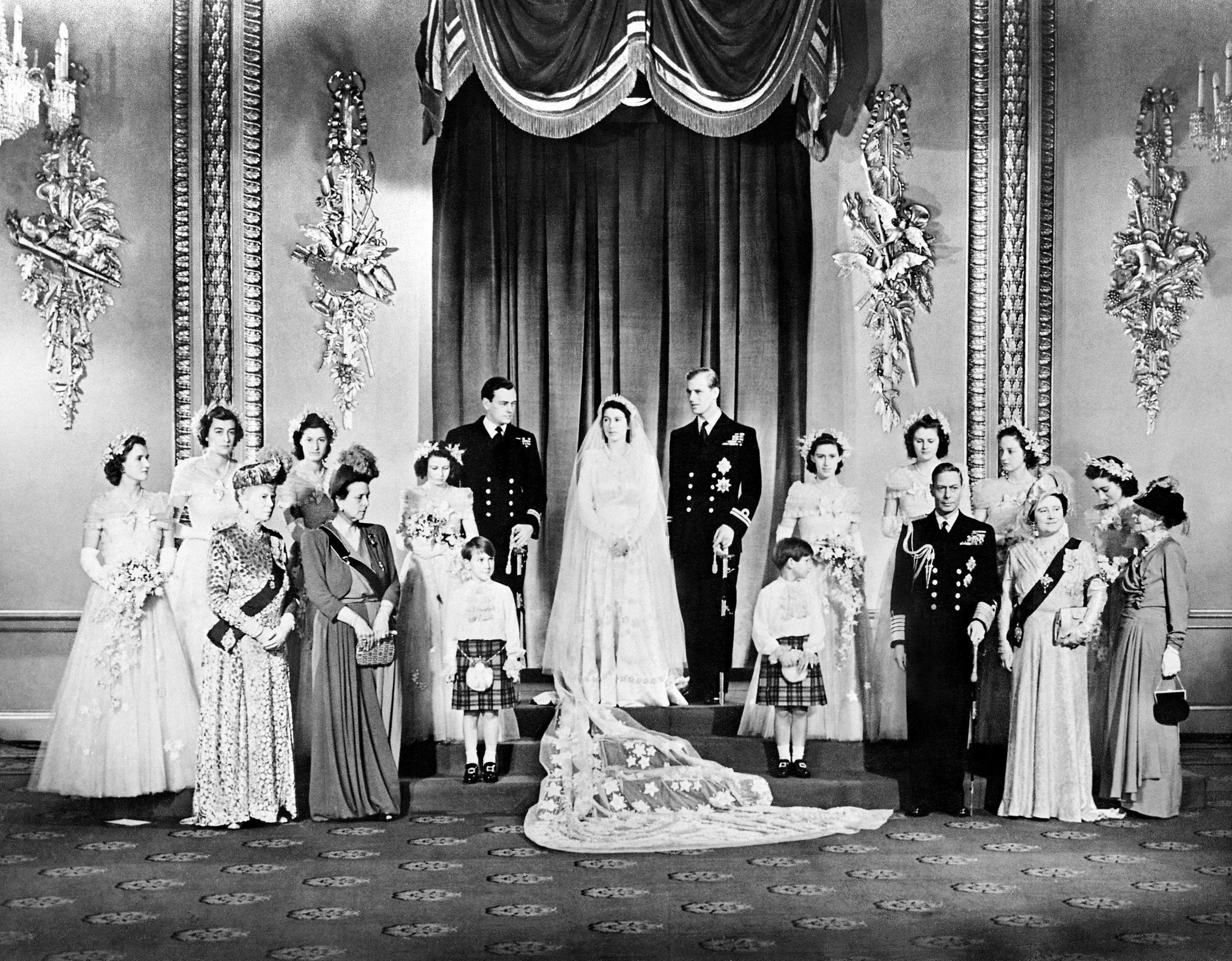 Members of the Royal Family pose around then Princess Elizabeth and Philip, Duke of Edinburgh in the Throne Room at Buckingham Palace on their wedding day, November 20, 1947.