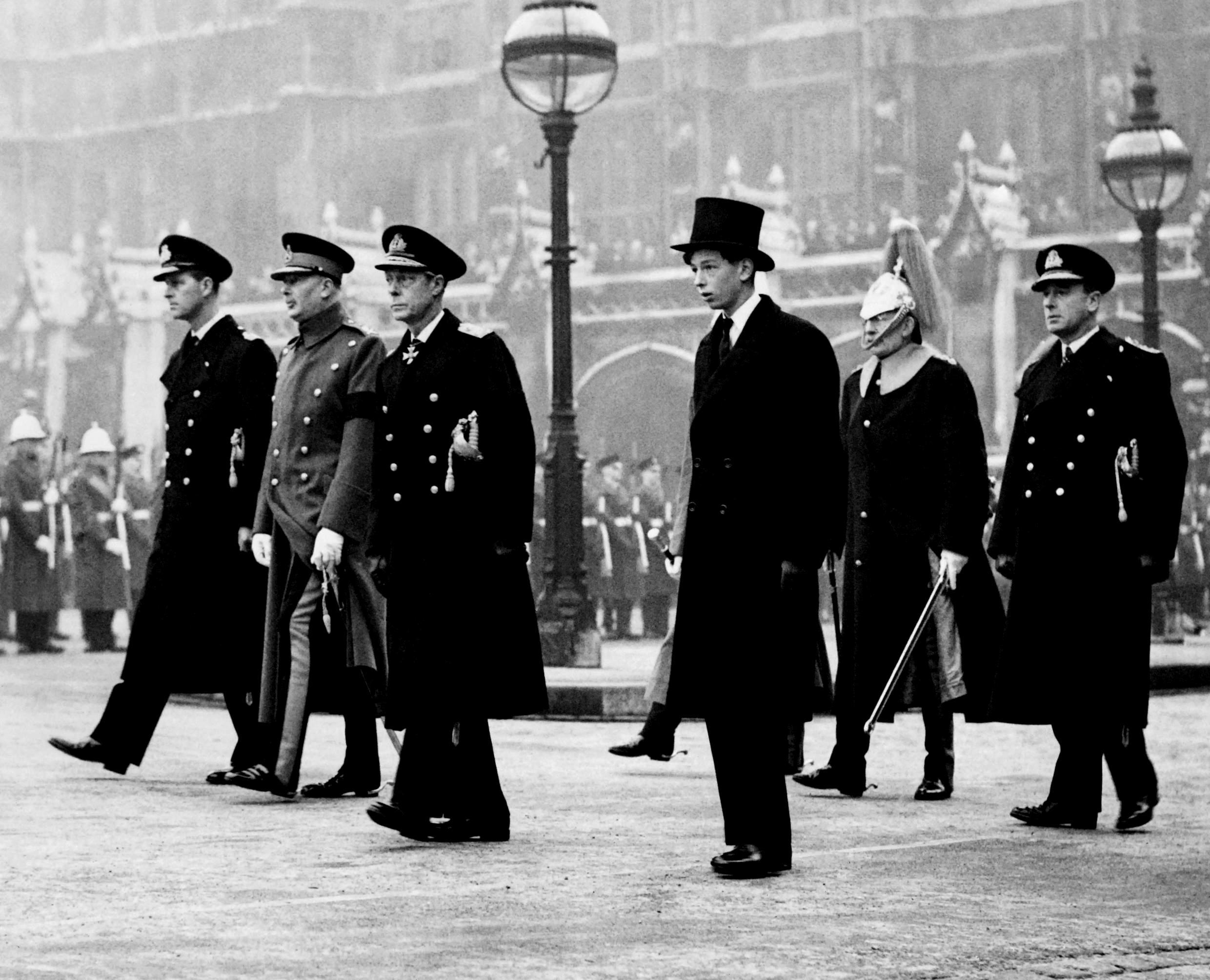 The four Royal Dukes -- the Duke of Kent, the Duke of Windsor, the Duke of Gloucester and the Duke of Edinburgh -- march behind the Royal coffin as the King's George VI  funeral procession begins in New Palace Yard outside Westminer Hall in London on February 15, 1952.