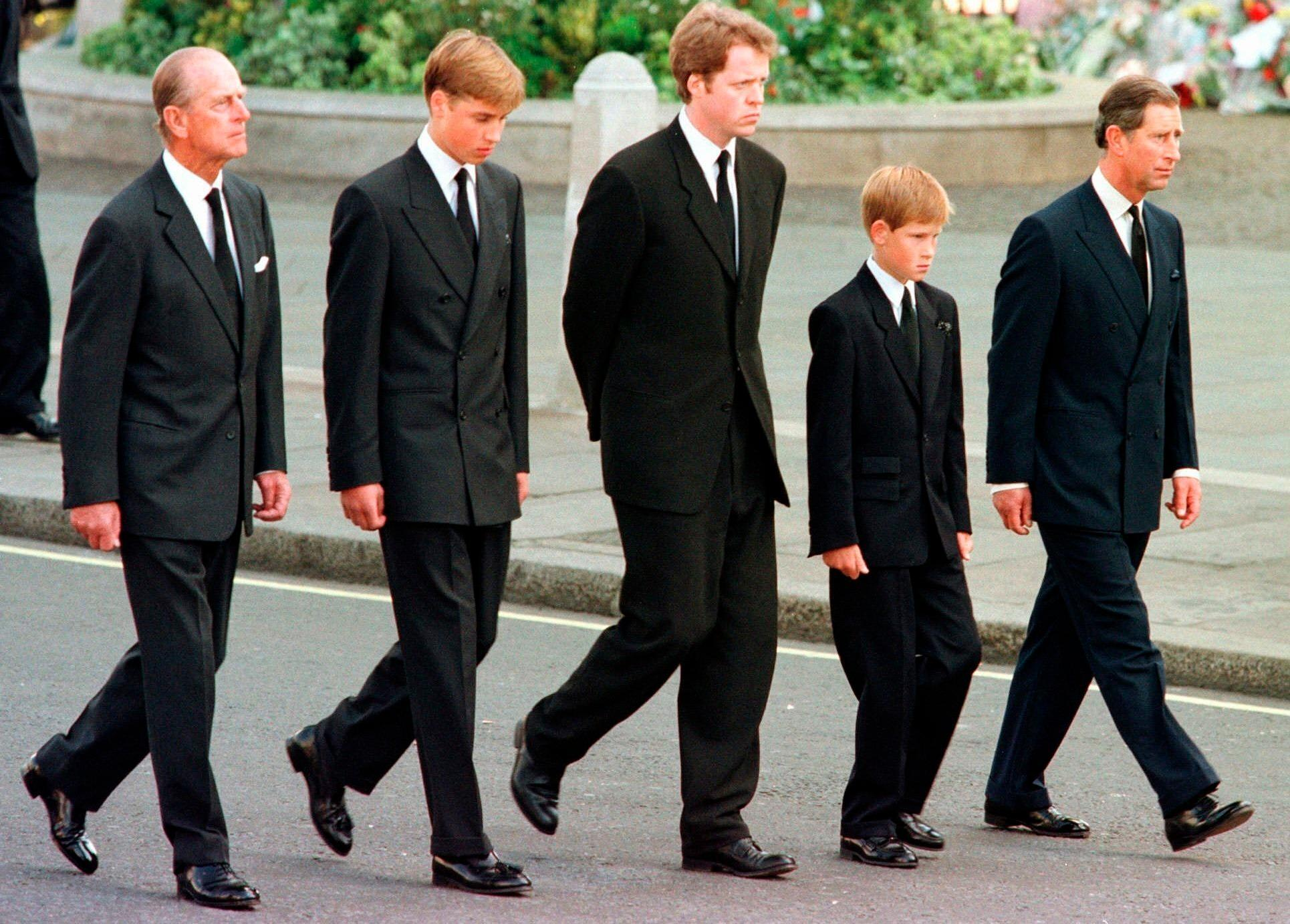 In this September 6, 1997 file photo, from left, Prince Philip, Prince William, Earl Spencer, Prince Harry and Prince Charles walk outside Westminster Abbey during the funeral procession for Diana, Princess of Wales.
