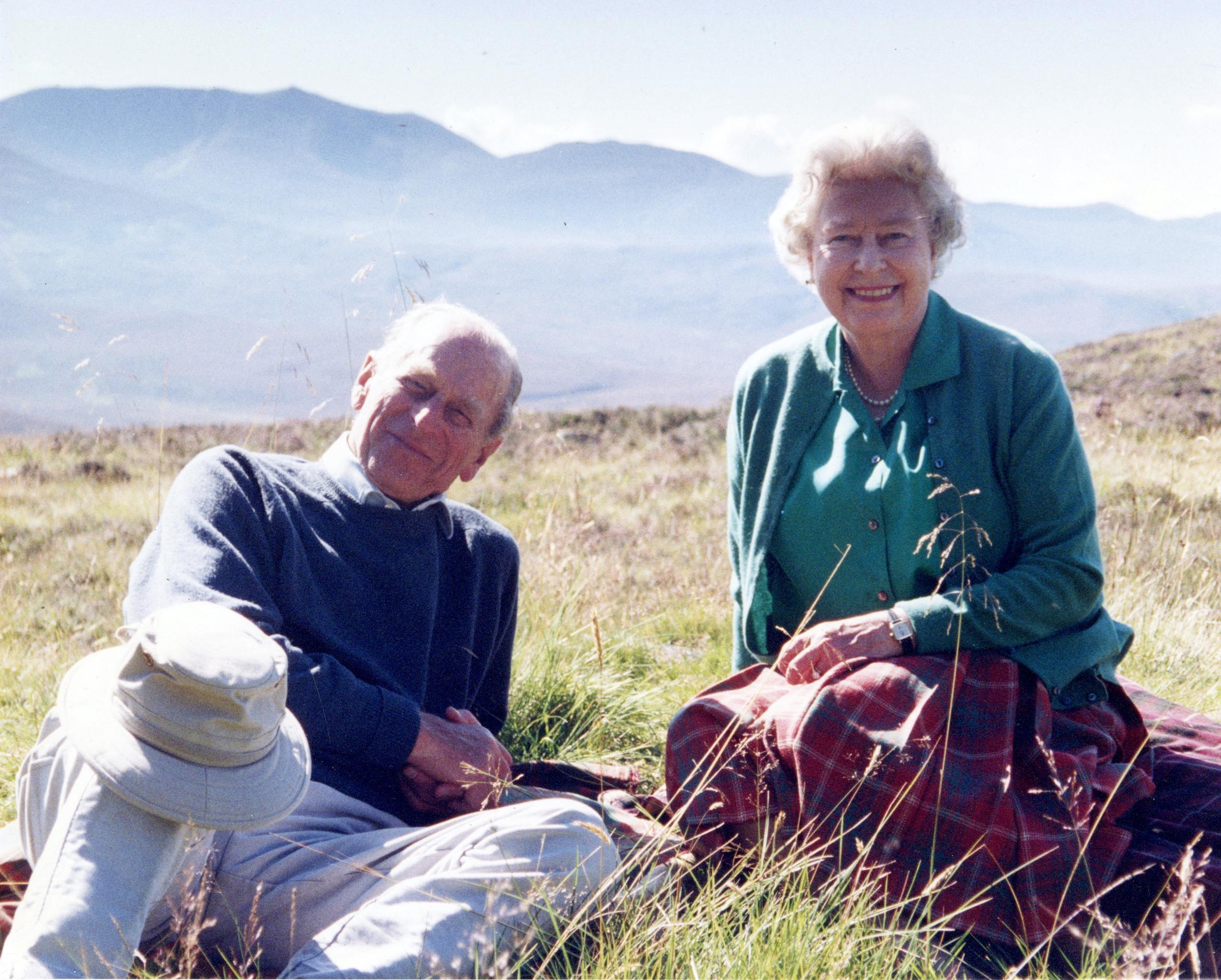 A photograph taken by the royal couple's daughter-in-law Sophie, Countess of Wessex, and released by Buckingham Palace on April 16, 2021, shows Britain's Queen Elizabeth II and her husband Britain's Prince Philip, the Duke of Edinburgh, at the top of the Coyles of Muick near Ballater in the Cairngorms National Park in Scotland in 2003.
