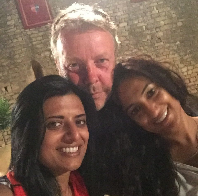 Kiran Sidhu (R) pictured with her husband (Centre) and her cousin (L) smile for a photo while on holiday