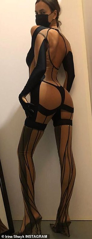 Racy: Irina also booked the Mugler fashion show — which was streamed virtually — and showed off her phenomenal figure in a barely there black garment on Instagram; pictured April 5