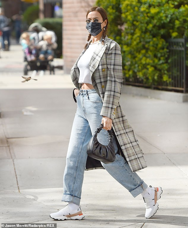 Foot forward:She wore a pair of futuristic looking Sorel sneakers on her feet and carried a small black handbag that was stylishly ruched