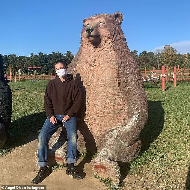 The series of eight photos ended with Thibodeaux sitting on a massive bear statue
