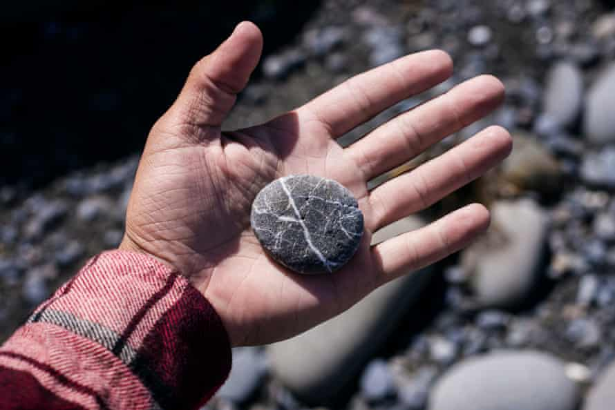 Hand holding a pebble