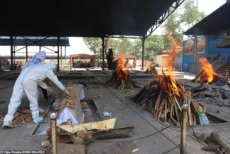 Burning pyres of patients who died of coronavirus at a crematorium in New Delhi
