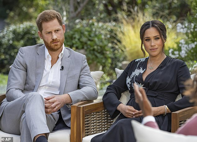 Harry told Oprah that he has been forced to seek corporate work after his father Prince Charles 'cut him off' financially after they emigrated to Canada and then on to LA. Pictured:Harry, from left, and Meghan, Duchess of Sussex, in conversation with Oprah Winfrey
