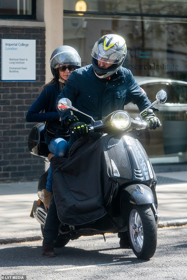 Off they go: The actor, 62, and the Ace Slippers founder, 42, nailed sporty style as they held onto their helmets before continuing their journey across the English capital