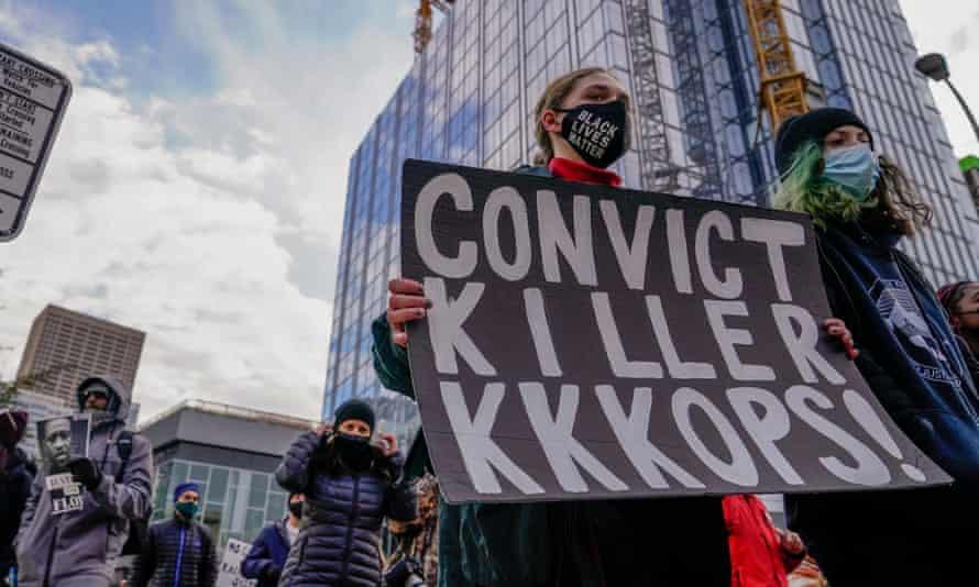 Demonstrators march through downtown Minneapolis on 19 April.