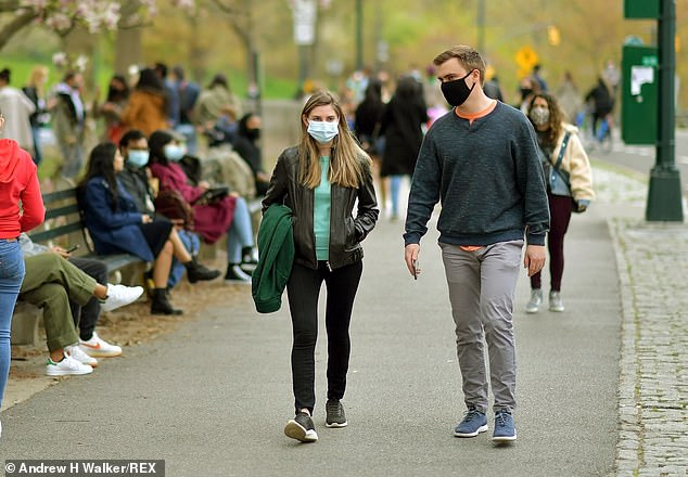 Walensky added that guidance about what fully vaccinated people can do, including mask-wearing, will continue to be updated as more people get shots. Pictured:New Yorkers in Central Park, April 18
