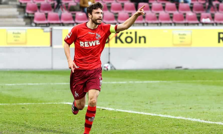 Köln's Jonas Hector celebrates his first goal against RB Leipzig.