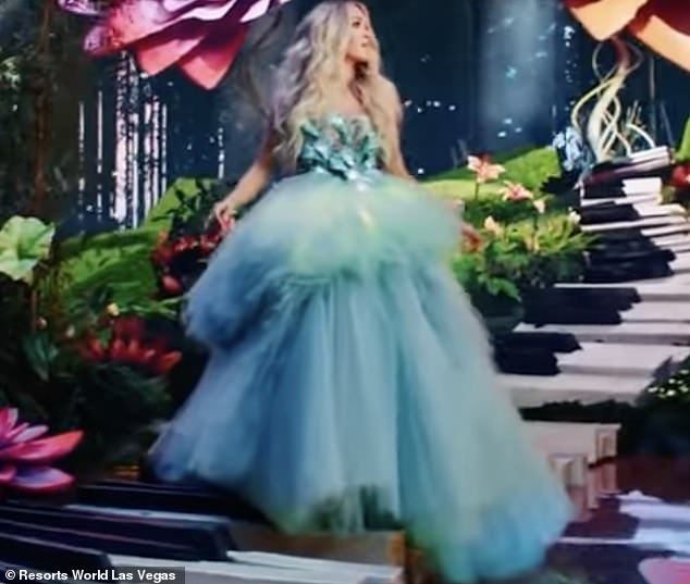 Hello, gorgeous:The blonde country star, who happens to have herself become a star as an American Idol winner, was wearing a sumptuous blue frock