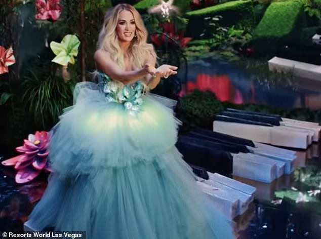 So musical:Letting her wavy blonde hair flow free she strolled cheerfully across a forest bridge constructed from gigantic piano keys