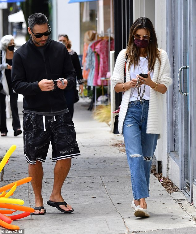 Casual: As for Richard, he kept ultra casual for his outing with Alessandra in a zip-up jacket, a pair of patterned shorts, and some flip flops