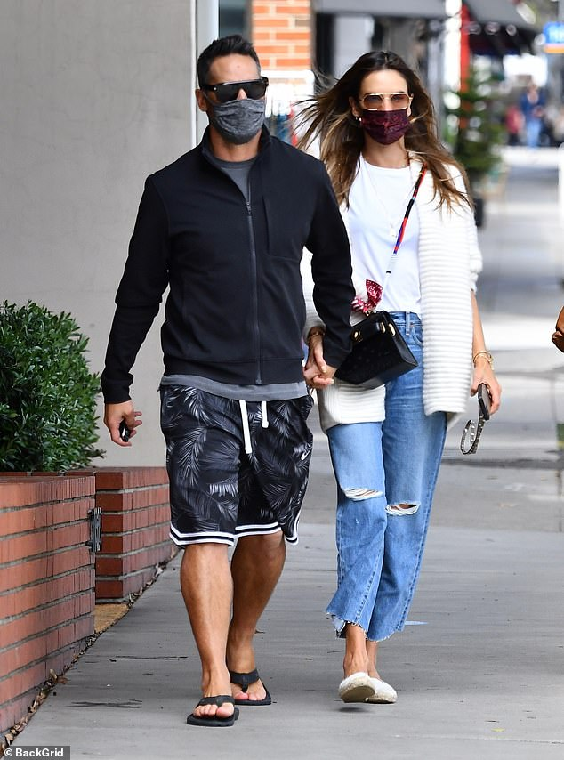 Lunch date: The former Victoria's Secret Angel, who rang in her 40th birthday earlier this month, held hands with the hunky model as they grabbed lunch in Brentwood, CA