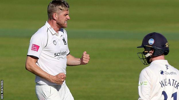 Olly Stone celebrates the wicket of Adam Wheater