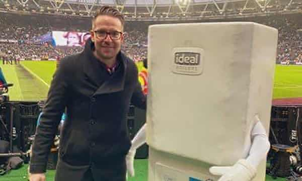 Chris Scull alongside Boiler Man, West Bromwich Albion's mascot, ahead of West Ham's FA Cup tie with West Brom at the London Stadium last January.