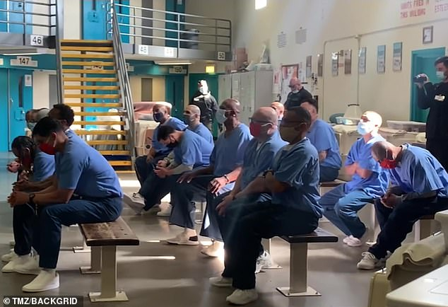 Captive audience:One inmate could be seen moving his head to the beat as Justin sang: 'Cause I've had everything but no one's listening and that's just f***ing lonely'