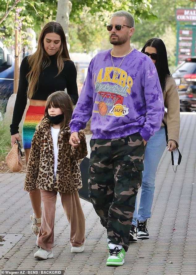 Couple: Amelia Hamlin, 19, and Scott Disick, 37, put on a united display as they headed out shopping with his daughter Penelope, eight, in Miami on Wednesday