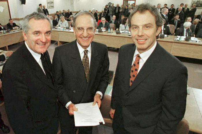Left to right: Then Irish Prime Minister Bertie Ahern with US Senator George Mitchell and Prime Minister Tony Blair at signing of Good Friday Agreement on April 10, 1998