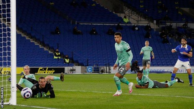 Neal Maupay's shot is deflected wide
