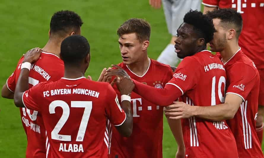Joshua Kimmich (centre) celebrates with his Bayern teammates after scoring their second goal.