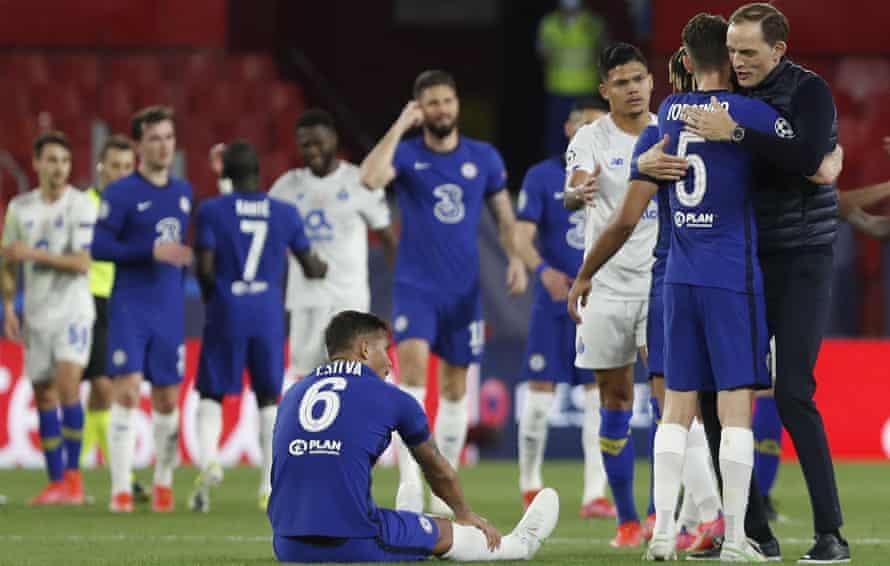 Thomas Tuchel celebrates with Jorginho but Thiago Silva sits on the ground