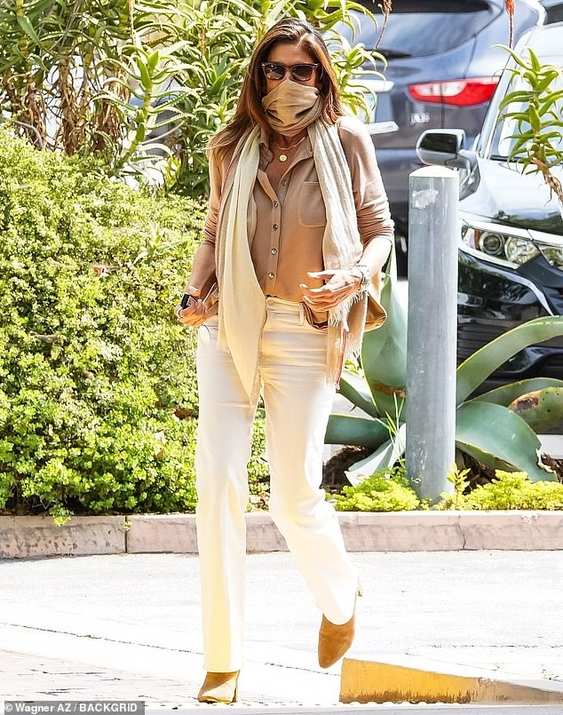 Taking care of business: Cindy Crawford, 55, pops by she and Rande Gerber's restaurant Cafe Habana in an elegant outfit rich in neutral tones