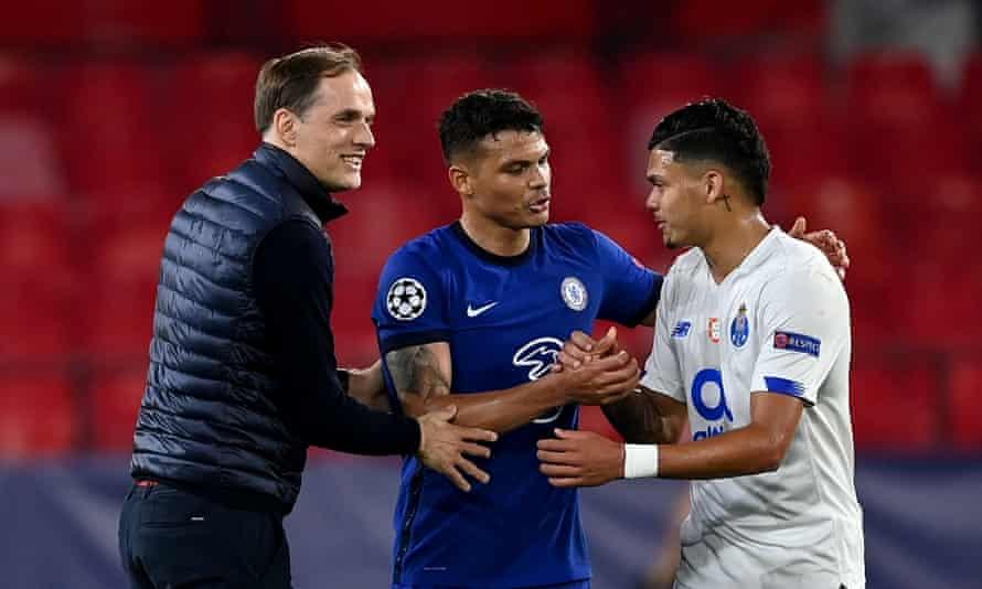 Thomas Tuchel and Thiago Silva of Chelsea commiserate with Porto's Evanilson