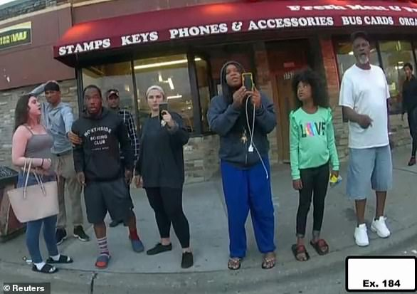 Judeah is pictured second from the right in a green shirt in video from Floyd's fatal confrontation with police that was shown in court