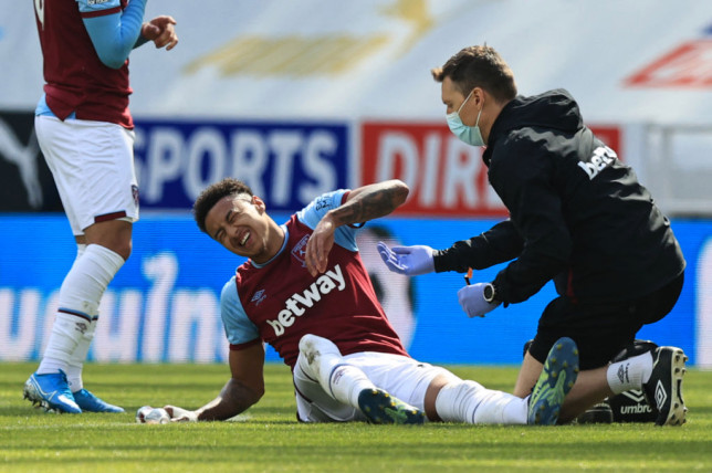 West Ham United's English midfielder Jesse Lingard reacts as he receives medications during the English Premier League football match between Newcastle United and West Ham United at St James' Park in Newcastle-upon-Tyne, north east England on April 17, 2021.