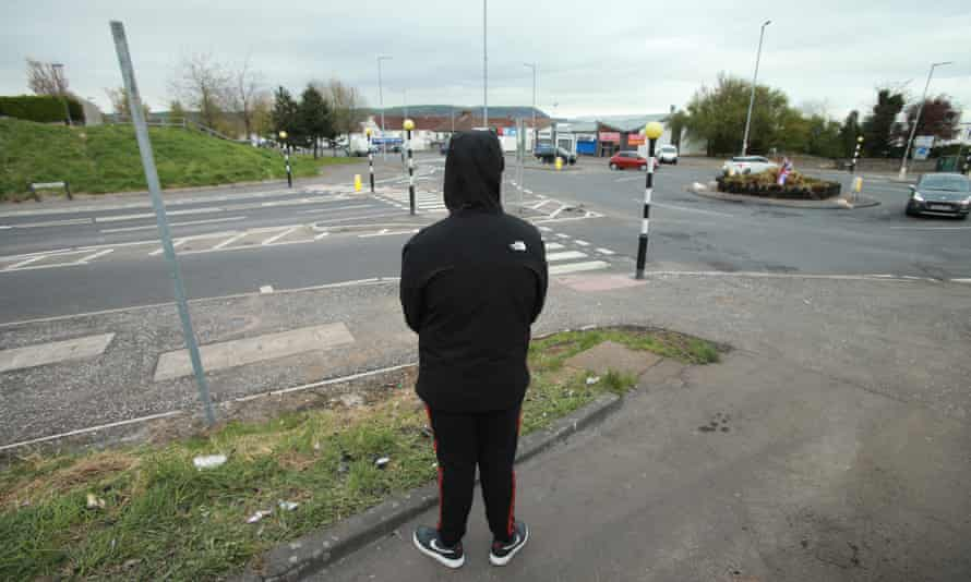 A young protestant call Bob watches over a roundabout in Newtownabbey.