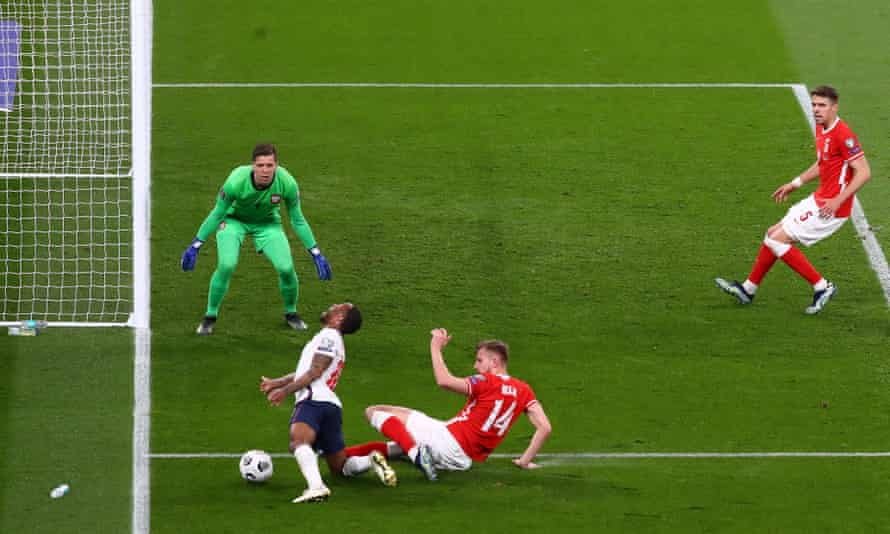 Raheem Sterling is brought down by Michal Helik for an England penalty, converted by Harry Kane.