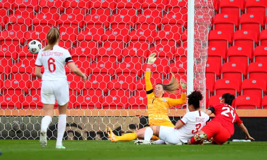 Canada's Evelyne Viens opens the scoring past Carly Telford of England