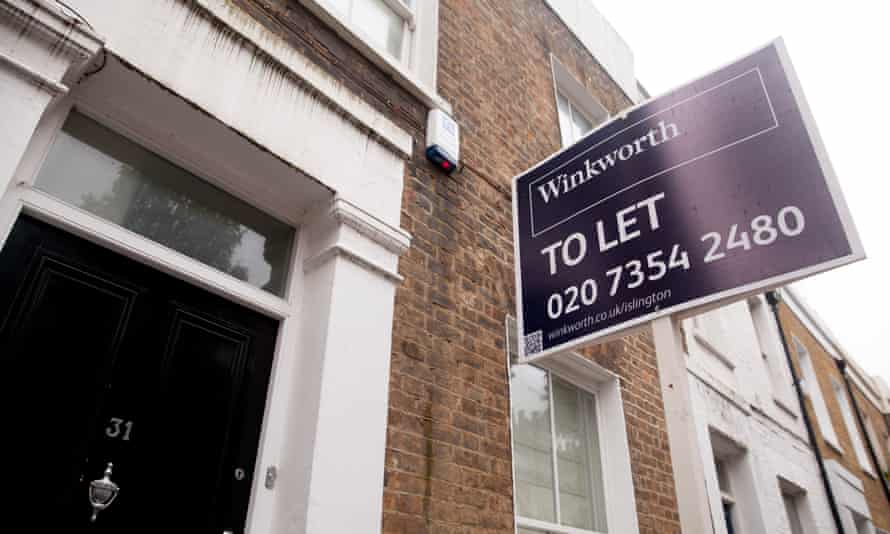 A white and purple Winkworth 'to let' sign on the side of a building