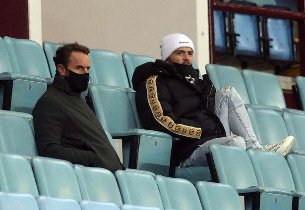 England manager Gareth Southgate and Aston Villa's Jack Grealish watch from the stands