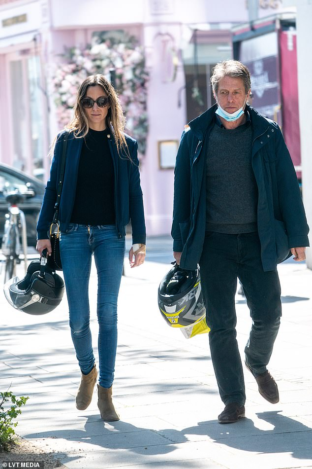 Just the two of us: Hugh Grant and Anna Eberstein enjoyed some quality time away from their work and parenting duties as they cruised through King's Road on his Vespa on Tuesday