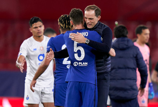 Thomas Tuchel, Manager of Chelsea FC and Jorginho of Chelsea FC celebrate following the UEFA Champions League Quarter Final Second Leg match between Chelsea FC and FC Porto at Estadio Ramon Sanchez Pizjuan on April 13, 2021 in Seville, Spain. Sporting stadiums around Spain remain under strict restrictions due to the Coronavirus Pandemic as Government social distancing laws prohibit fans inside venues resulting in games being played behind closed doors.