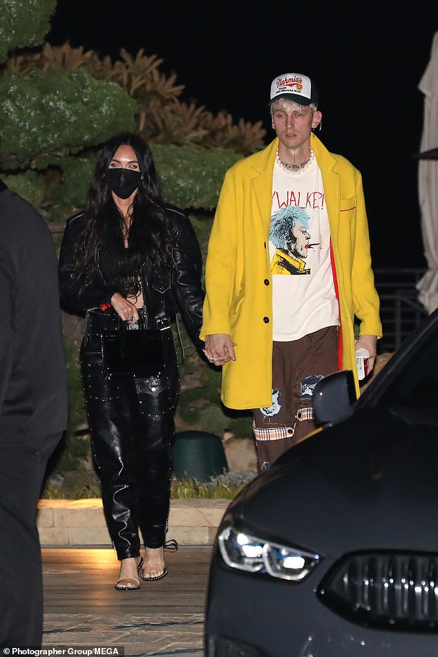 Hold me close:Megan Fox and Machine Gun Kelly enjoyed a romantic date night on Thursday as they departed Nobu in Malibu in typically edgy ensembles