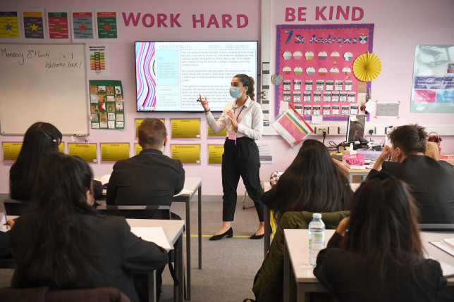 More than a third of teachers do not see themselves working in education in five years' time, a National Education Union (NEU) survey suggests. Children and the teacher wearing facemasks during a lesson at Hounslow Kingsley Academy in West London.