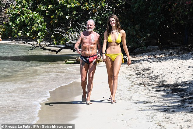 On the mend: Paul Gascoigne enjoyed a stroll along the beach with his co-star Beatrice Marchetti during filming for Italian's I'm A Celebrity in Honduras on Saturday