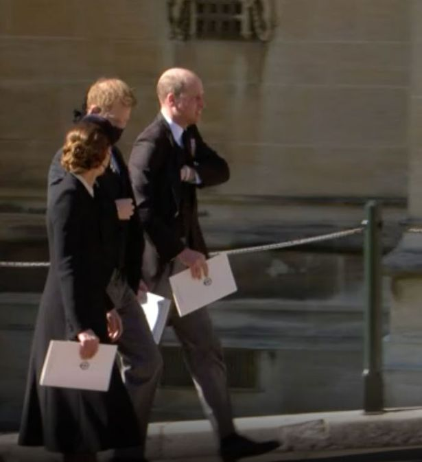 Prince Harry walks with Prince William and Kate Middleton after Prince Philip's funeral