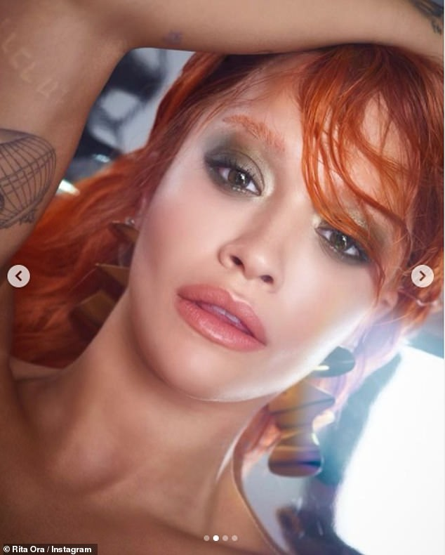 Big change:Rita Ora swapped her light tresses for red hair in sultry new snaps uploaded to her Instagram on Thursday