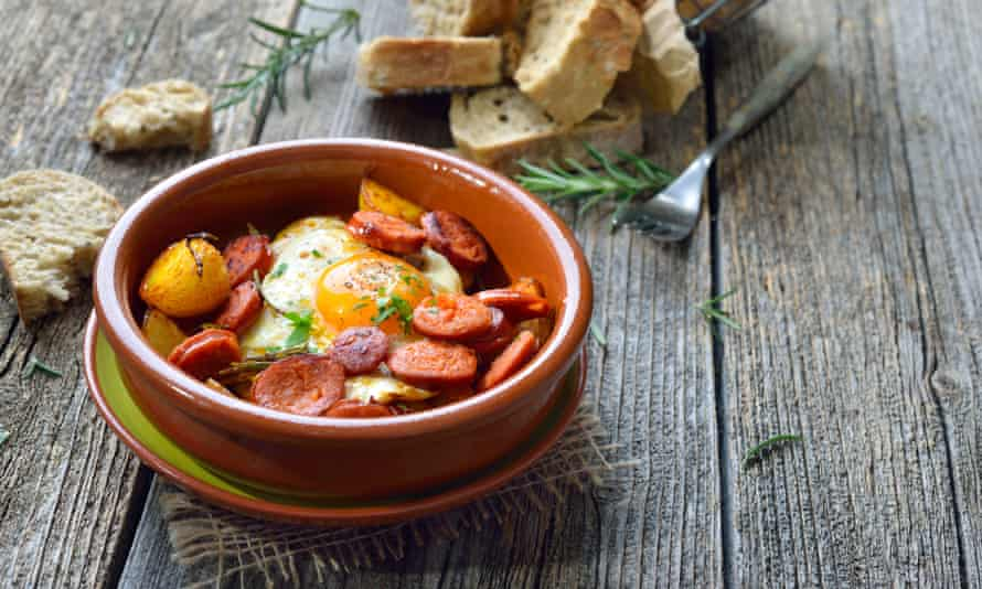 Spicy chorizo sausage with fried egg and baby potatoes.